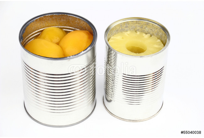 The tins with peaches and pineapples on the white background 64239