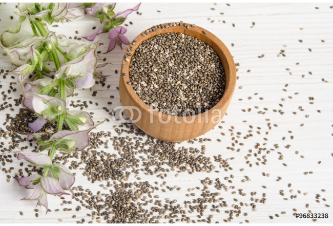 Chia seed healthy super food with flower over white wood backgro 64239