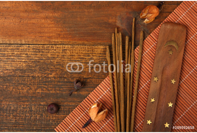 fragrant incense on a brown wooden background 64239