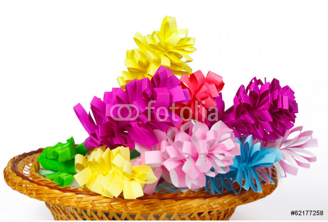 Many colored paper flowers in the basket 64239