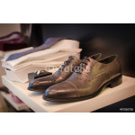 Shoes, shirts and other clothes in a men fashion store. 64239