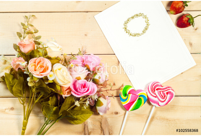 Roses flowers and empty tag for your text with heart-shaped cand 64239