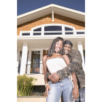 Portrait of couple in front of house 64239