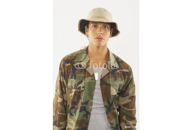 Portrait of young male soldier in fatigues 64239