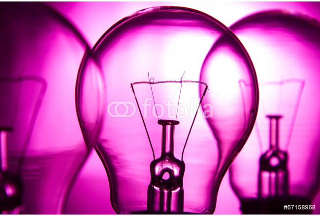 Row of light bulbs on a bright pink background 64239