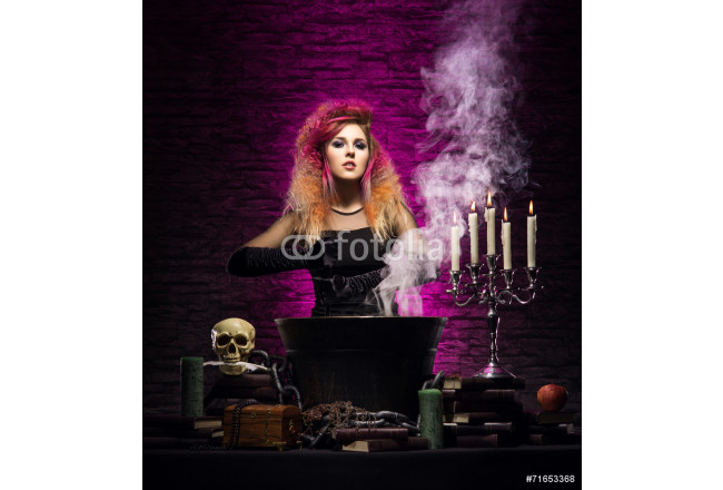 Young and beautiful witch making witchcraft in the dungeon 64239