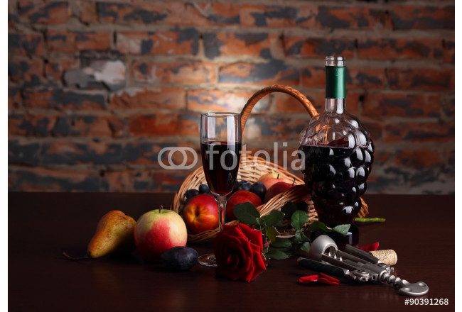 Still life with fruit and glass of wine on the background of a brick wall.. 64239