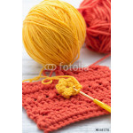 Yellow and orange yarn with crochet hook 64239
