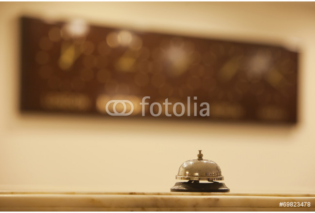 old hotel bell on a marble stand 64239