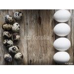 Easter eggs on wood board background with space for copy, text 64239