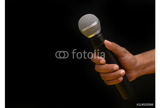 Professional holding microphone in hand while giving motivational speach 64239