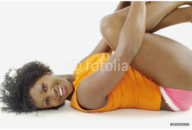 Portrait of woman laying down with arms wrapped around knees 64239