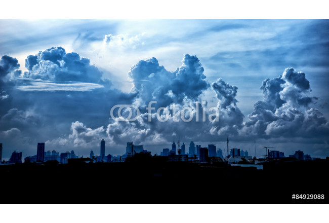 Dark blue storm clouds over city in rainy season 64239