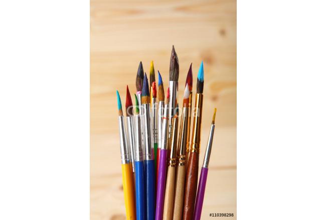 Paint brushes on wooden background. Selective focus 64239