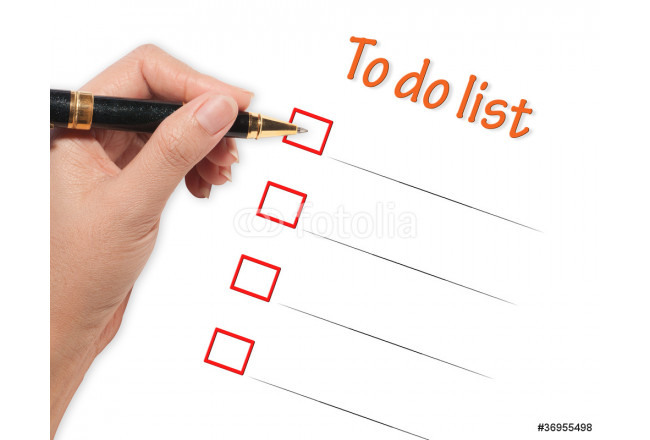 female hand checking to do list 64239