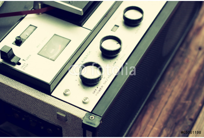 lose up of old reel to reel recording machine 64239