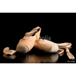 Pair of ballet shoes on a dark background 64239