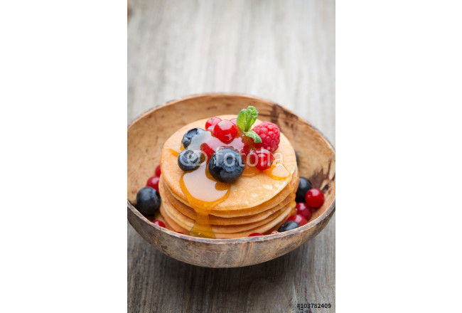 Stack of pancakes with blueberry and fresh berry. 64239