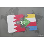 puzzle with the national flag of bahrain and comoros on a world map background. 64239