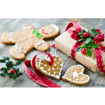 Christmas gift box and gingerbread cookies on wooden background 64239