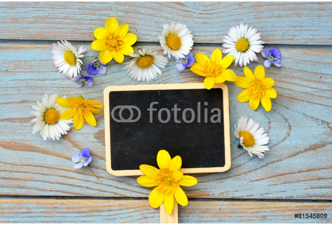wooden background with black empty chalk board and fieldflowers 64239