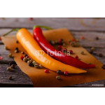 Two hot chili peppers with pepper seeds 64239