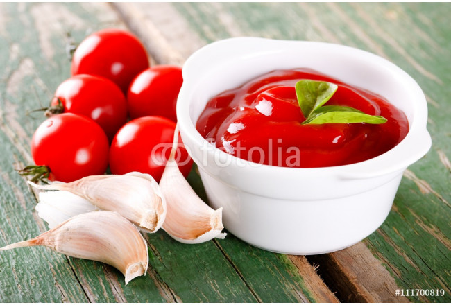 White bowl with ketchup with tomatoes and garlic 64239