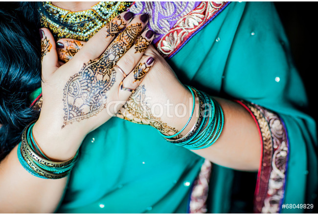 Hands painted with henna close up 64239