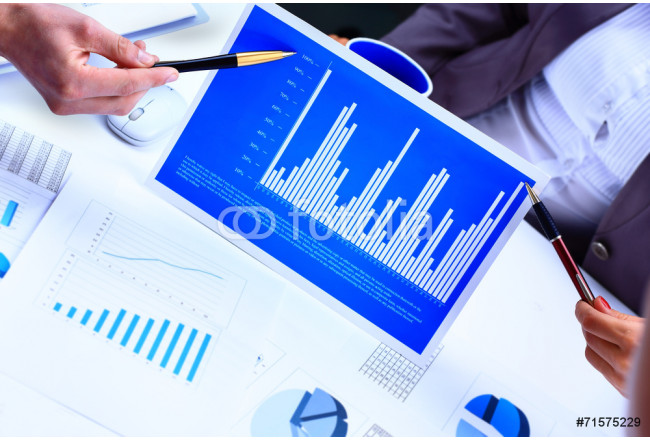 Financial paper charts and graphs on the table 64239