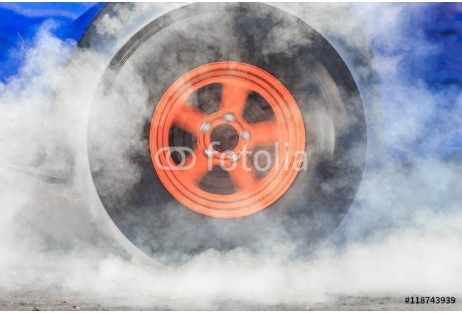Drag racing car burns rubber off its tires in preparation for the race 64239