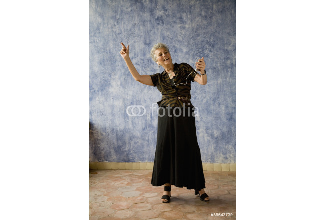 Senior woman dancing with mp3 player 64239