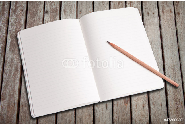 Open notebook and pencil on wood patio 64239
