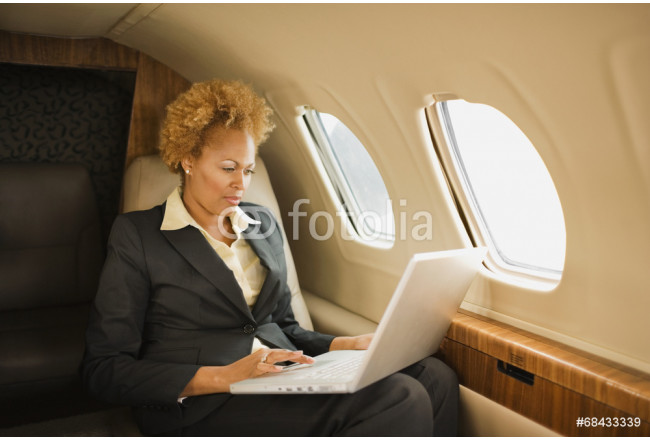 African American businesswoman on airplane 64239