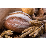 Assortment of baked bread on wooden table background 64239