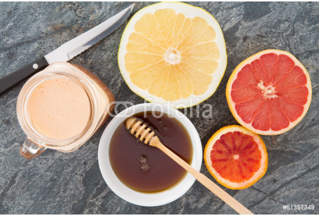 Fresh grapefruit and juice served with honey 64239