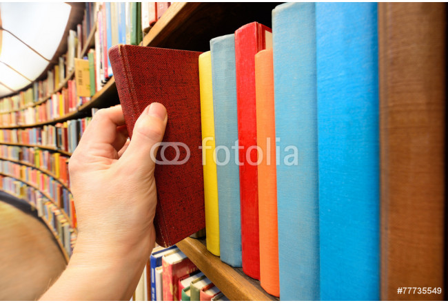 Hand picking book in library 64239