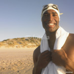 Man in swimming cap with towel around neck 64239