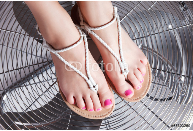 Close-up portrait of pedicured female foot with trendy gel polis 64239