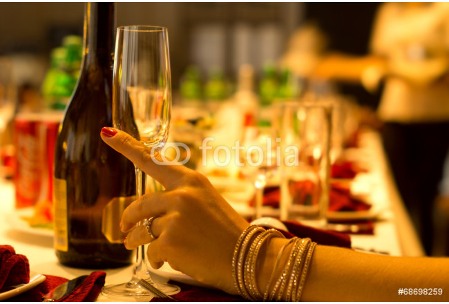 Stylish woman drinking champagne at a dinner party 64239