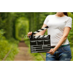 Woman holding clapper board in her hands. tunnel of love in ukra 64239