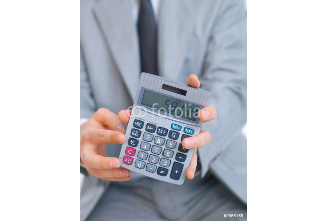 Close up of middle aged business man using calculator 64239