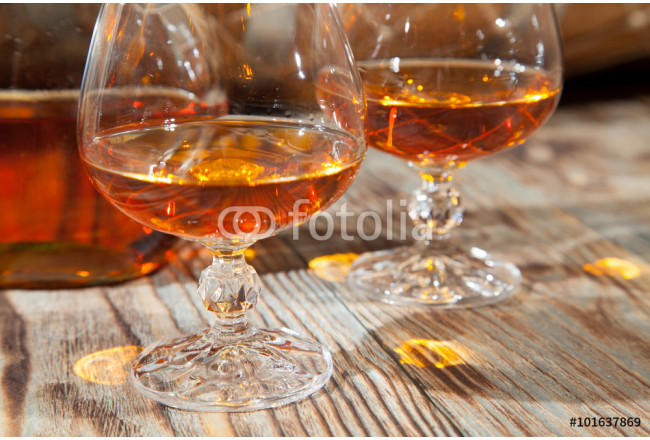 Glasses of cognac and a bottle 64239