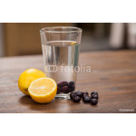 Berries and lemon infusion in a kitchen 64239