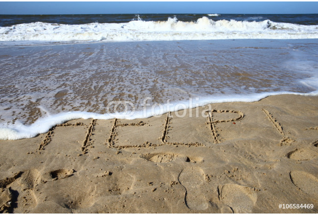 help/ words written in the sand on a beach  64239
