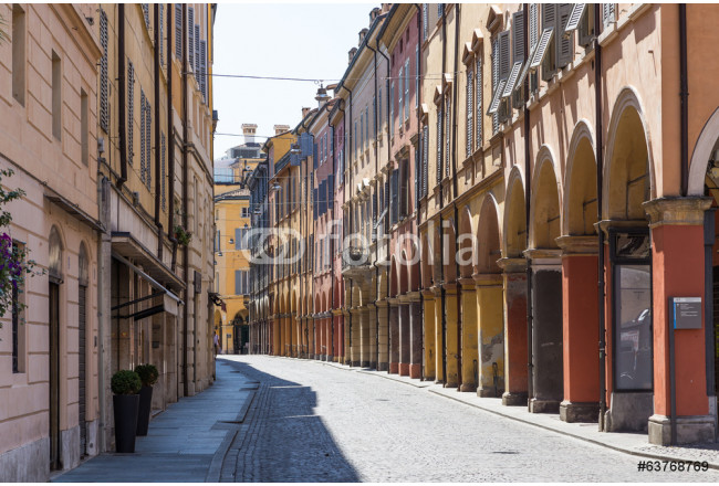 medieval street in old town of Modena, Italy 64239