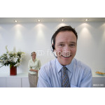 Businessman with headset, smiling, portrait 64239