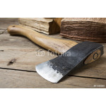 Wooden handle axe lying on wooden table 64239