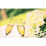 champagne flutes on wedding flowers background 64239