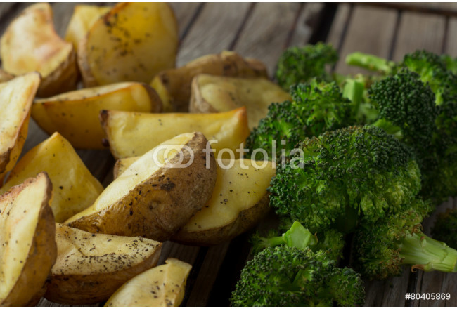 Potatoes and broccoli on grill 64239