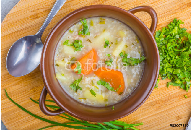 Traditional barley soup in a bowl 64239